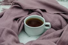 Cup of tea and scarf stock image