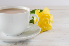 Cup of tea with a yellow rose Royalty Free Stock Photo