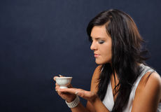A cup of tea. Young woman with a cup of tea stock photography