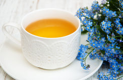 Cup of teand forget me not flowers Royalty Free Stock Photo