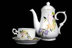 Cup and teapot. Set of ornate porcelain teapot and cup with saucer Royalty Free Stock Images