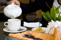 Cup and teapot in cafe Stock Photo