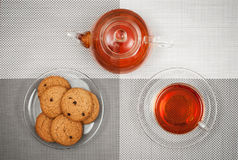 Cup and teapot. Photo of a cup and teapot with tea stock images