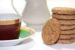 Cup of teat with biscuits as the tower in the shallow depth of f Royalty Free Stock Images