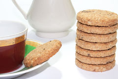 Cup of teat with biscuits as the tower Royalty Free Stock Photos