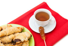 A cup of tee with sugar stick and home made cookies Royalty Free Stock Images