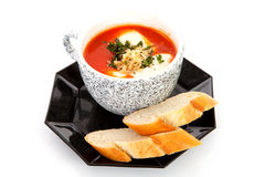 Cup with tomato soup and bread Stock Photo