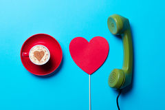 Cup, toy and handset Stock Photos