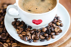 Cup of Traditional Black Coffee and Coffee Beans Stock Image