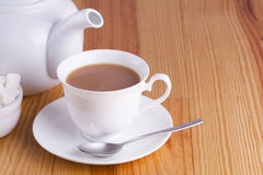 Cup of traditional English Tea with spoon Stock Image