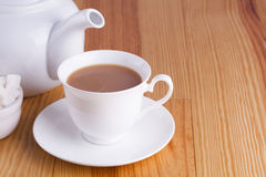 Cup of traditional English Tea teapot and sugar lumps Royalty Free Stock Image
