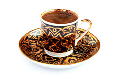A cup of Turkish coffee. Turkish Coffee in a traditional coffee cup. Isolated on white Stock Image