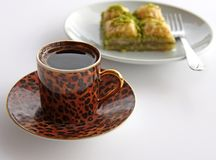 A Cup of Turkish Coffee and Baklava with pistachios. A Cup of Turkish Coffee served with Four Slices of Baklava with pistachios stock images