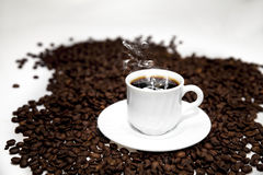 Cup of Turkish coffee on beans. Cup of coffee on coffee beans  on white Stock Photo