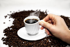 Cup of Turkish coffee on beans. Cup of coffee on coffee beans  on white Stock Images