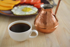 Cup of Turkish coffee and cezve Royalty Free Stock Photography