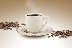 Cup of Turkish coffee with clipping path. Turkish coffee with coffee beans spilled on the edge Royalty Free Stock Photos