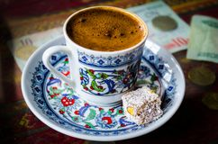Cup of Turkish coffee in a hookah cafe. Turkish coffee in a hookah cafe with a turkish delight, Istanbul, Turkey Royalty Free Stock Photo