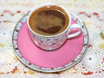 A Cup of Turkish Coffee on Lace. Ready to drink royalty free stock photography