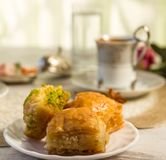 Cup of Turkish coffee and a plate with baklava Stock Photos