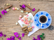 A cup of Turkish coffee with sweets and spices on a wooden surfa Royalty Free Stock Images