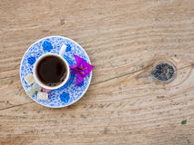 A cup of Turkish coffee with sweets and spices on a wooden surfa Stock Photos