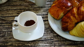 Cup with turkish coffee on the table with traditional delights on the background. stock video footage