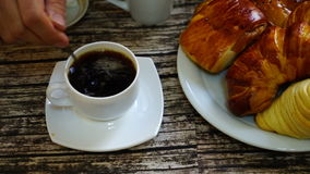 Cup with turkish coffee on the table with traditional delights on the background. stock footage