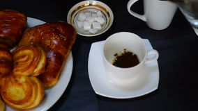 Cup with turkish coffee on the table with traditional delights on the background. stock video