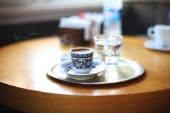 22.10.2016 Turkey, Istanbul - Turkish coffee with water royalty free stock photography