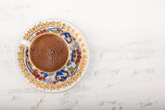 A cup of Turkish coffee on wooden surface royalty free stock images
