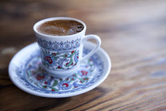 A cup of Turkish coffee on wooden table Royalty Free Stock Photography