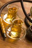 Cup of turkish tea and hookah Stock Photos