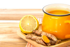A cup of Turmeric Tea with lemon and ginger , Benefits for reduce Inflammation , Liver Detox and Cleanser healthy herb drink. Concept royalty free stock photo