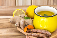 a cup of Turmeric Tea with lemon and ginger , Benefits for stock photo