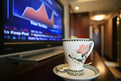 Cup with TV show some chart. Cup with TV show some financial chart Royalty Free Stock Photos