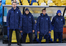 Cup of Ukraine: FC Dynamo Kyiv v Zorya Luhansk in Kiev. KYIV, UKRAINE - OCTOBER 26, 2016: Head coach of FC Dynamo Kyiv Sergiy Rebrov L and his assistants listen royalty free stock images