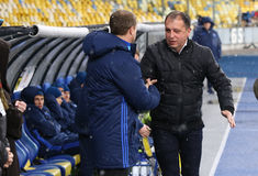 Cup of Ukraine: FC Dynamo Kyiv v Zorya Luhansk in Kiev. KYIV, UKRAINE - OCTOBER 26, 2016: FC Dynamo Kyiv manager Sergiy Rebrov L shakes hands with Zorya Luhansk royalty free stock photo