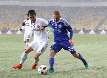 Cup of Ukraine: FC Dynamo Kyiv v Zorya Luhansk. KYIV, UKRAINE - OCTOBER 26, 2016: Vitaliy Buyalskiy of FC Dynamo Kyiv (R) fights for a ball with Artem Hordiyenko royalty free stock image