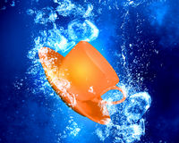 Cup under water Royalty Free Stock Photo