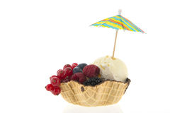 Cup vanilla ice with fruit and parasol Royalty Free Stock Photo