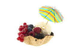 Cup vanilla ice with fruit and parasol Royalty Free Stock Photography