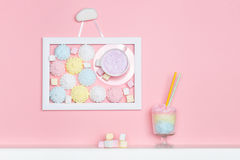 Cup of the wall. Minimal style. Vanilla candy. Pastel marshmallows Royalty Free Stock Photo