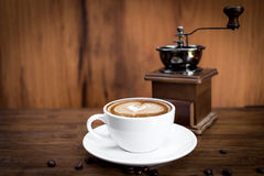 cup of warm coffee and coffee grinder Royalty Free Stock Images