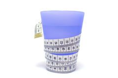 Cup of water. Calculation calories. Blue, plastic cup of water with tape-measure Stock Image