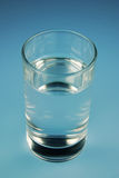 Cup water and. Blue cup of mineral water Royalty Free Stock Photography