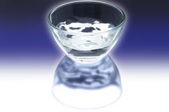 The cup of water in the dark Stock Photos