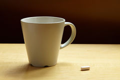 Cup of water with one pills Stock Photo