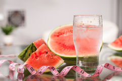 Cup of water and watermelon, diet concept Royalty Free Stock Photos