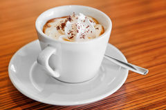 Cup of whipped cream coffee Royalty Free Stock Photo